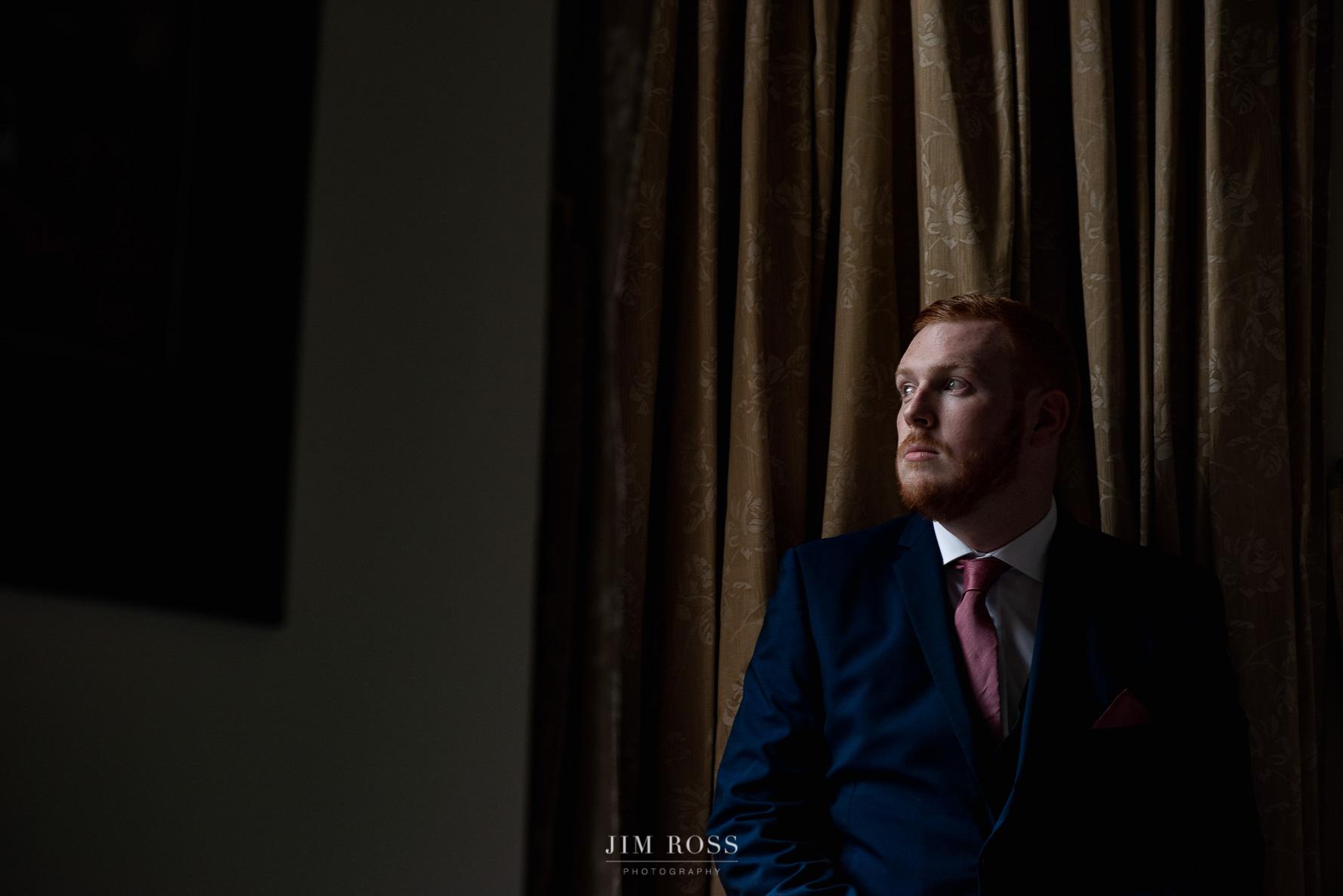 Groom portrait in Manor bedroom
