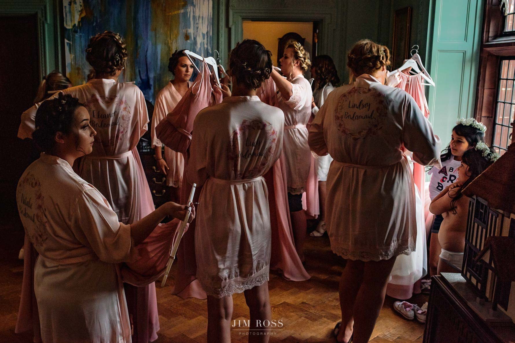 Bridesmaids checking dresses