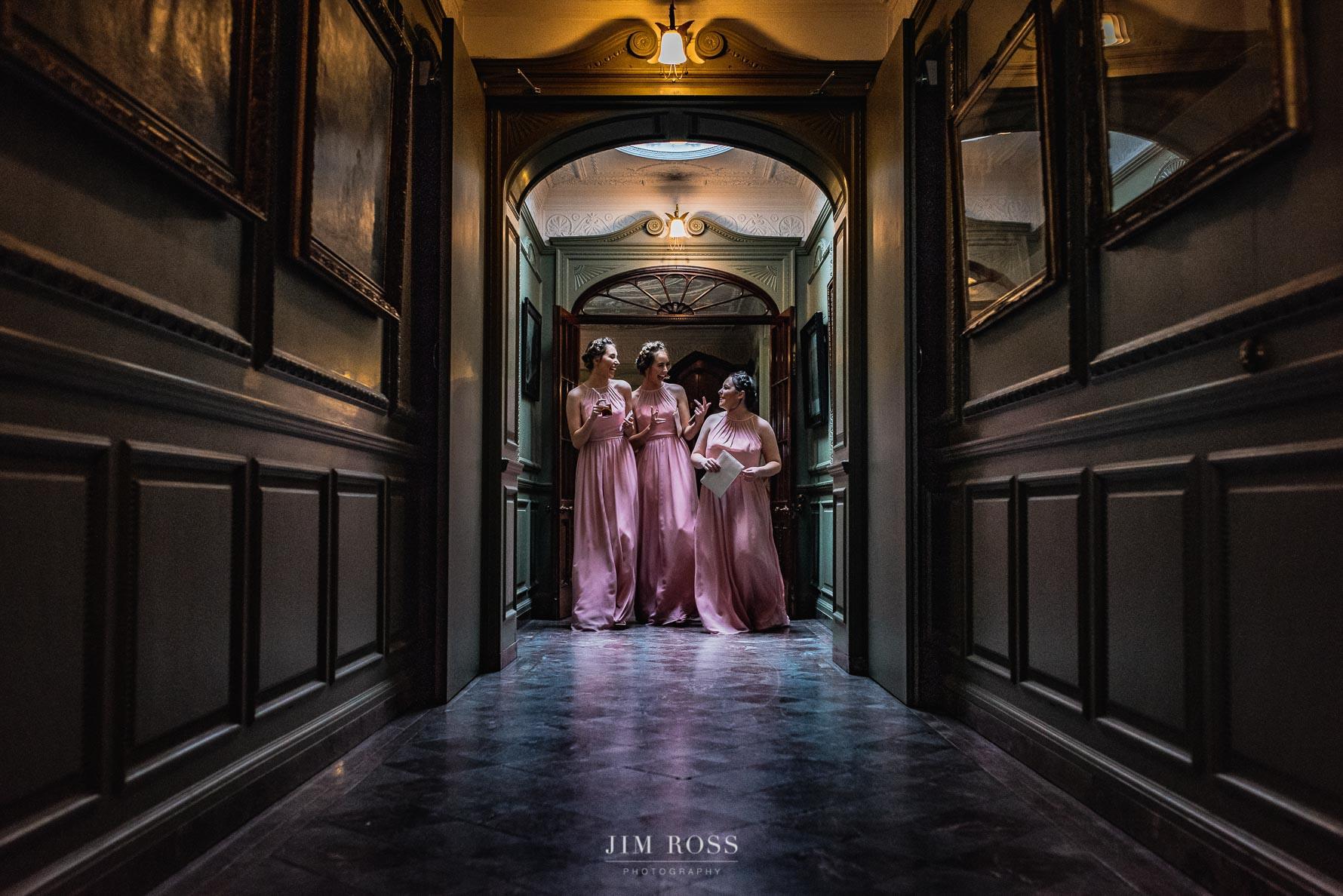 Bridesmaids in panelled corridor