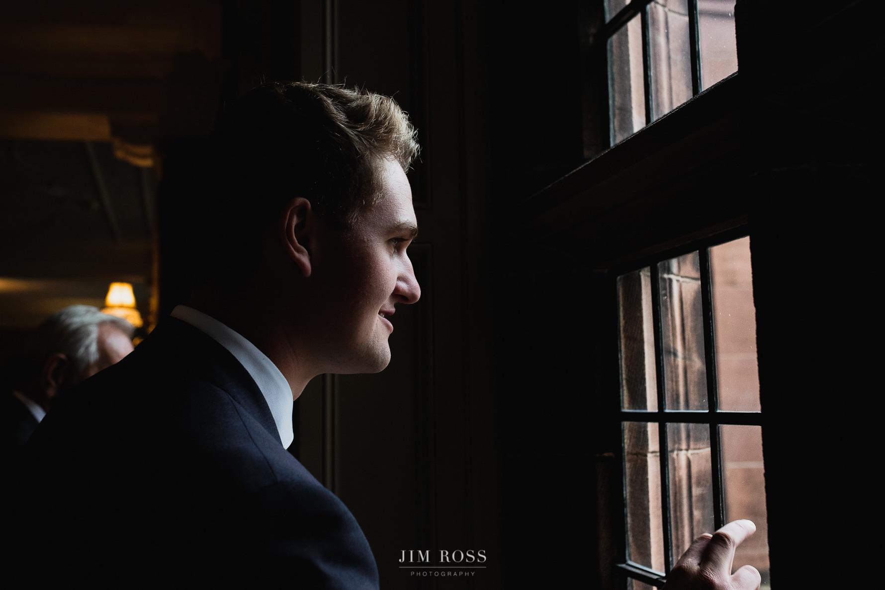 Peering through historic window