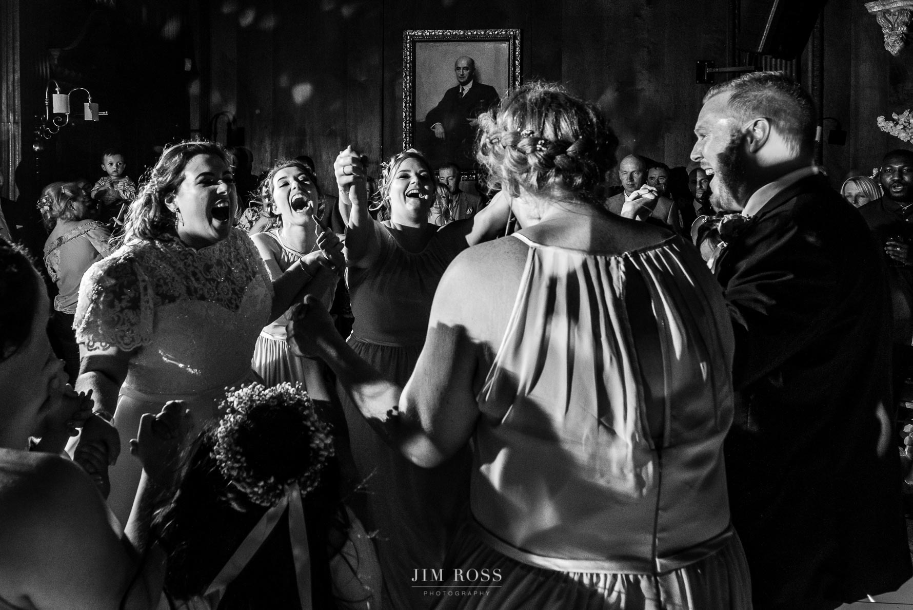 Portrait painting looks on to wedding dancing fun