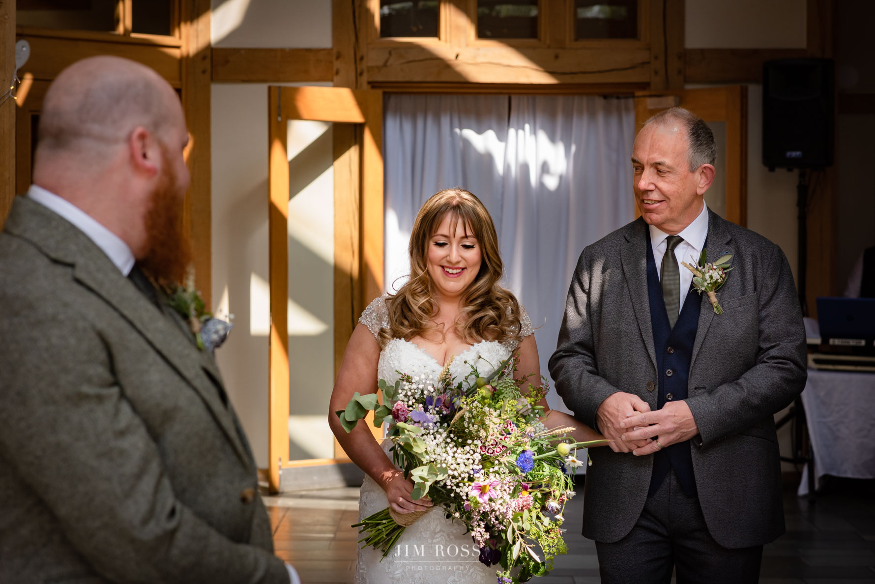 Dad and bride approach the groom