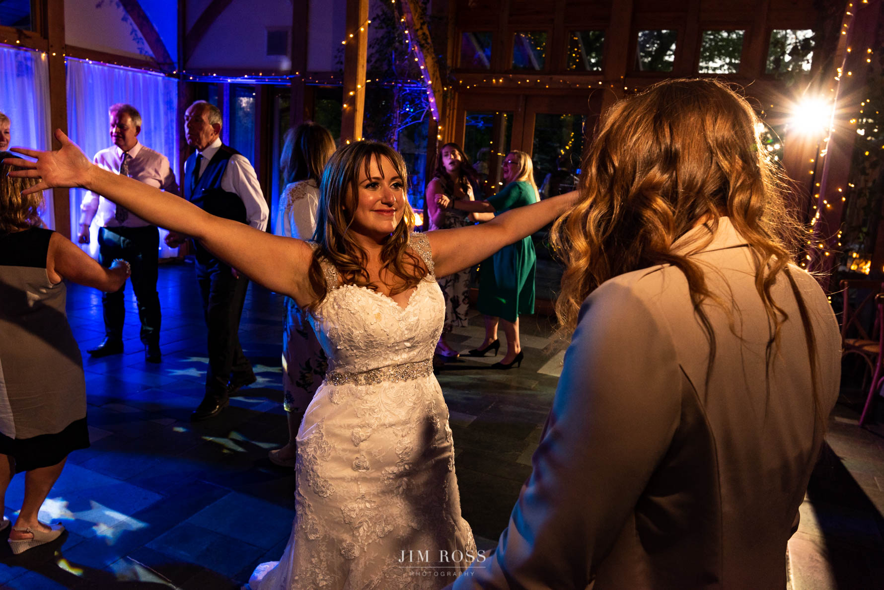Bride and friends dancing