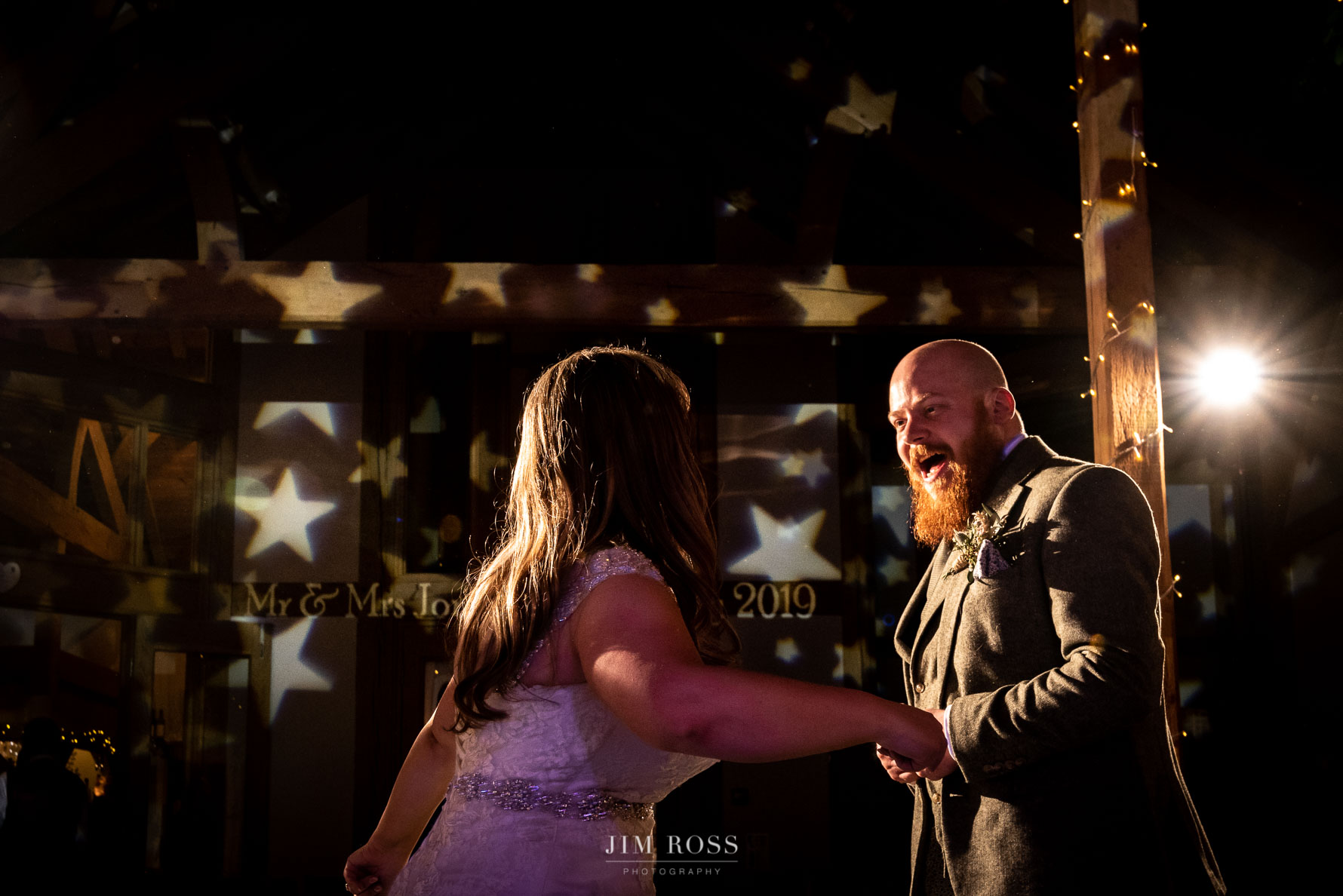 Groom dancing with new wife