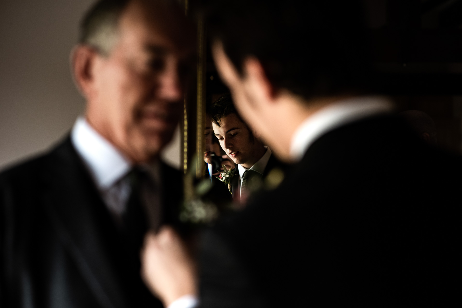 Groom prep in mirror