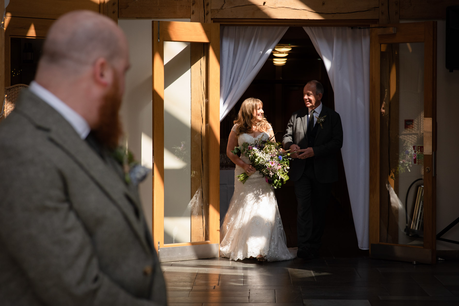 Bride arrives with Dad in good light