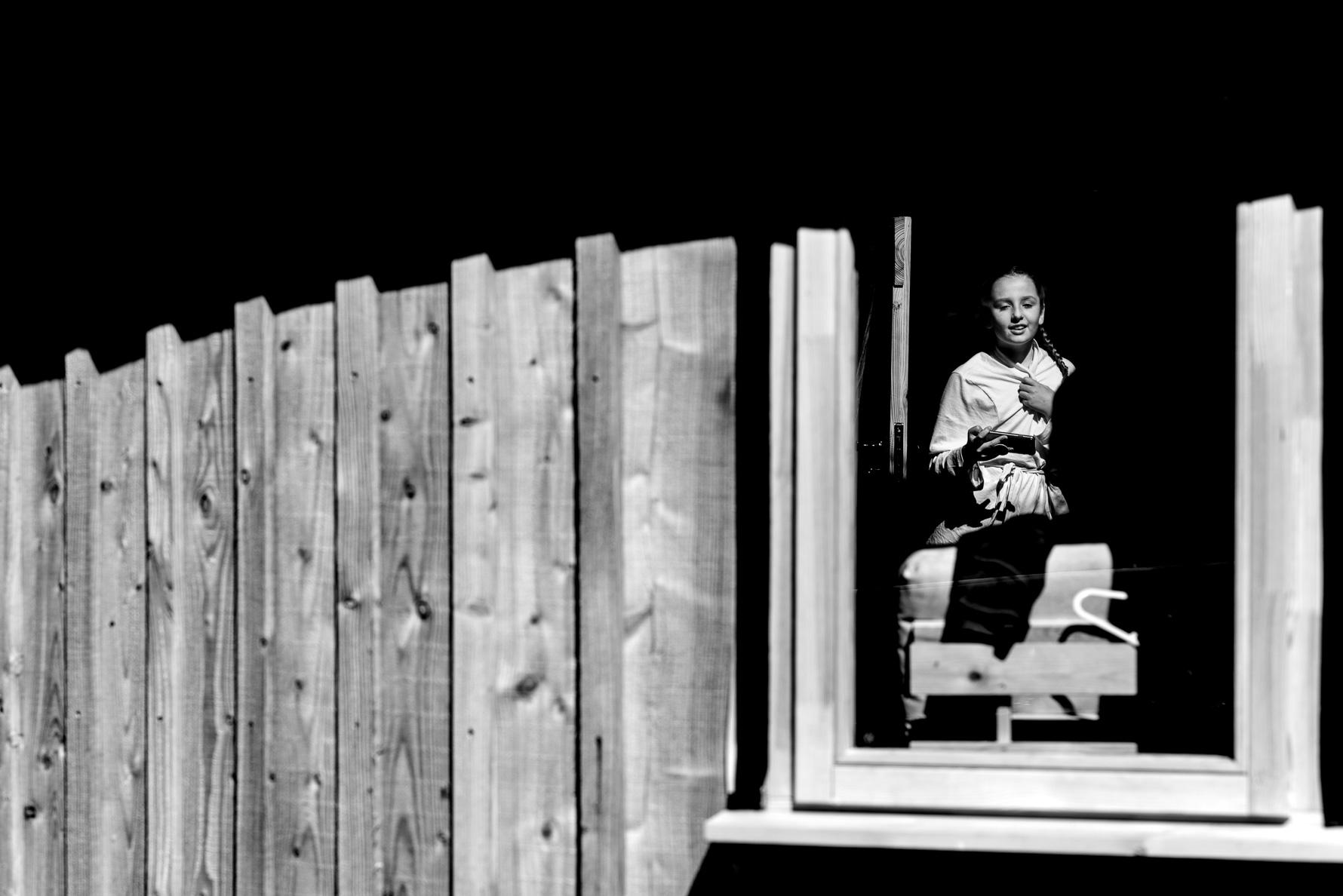 Daughter through yurt window