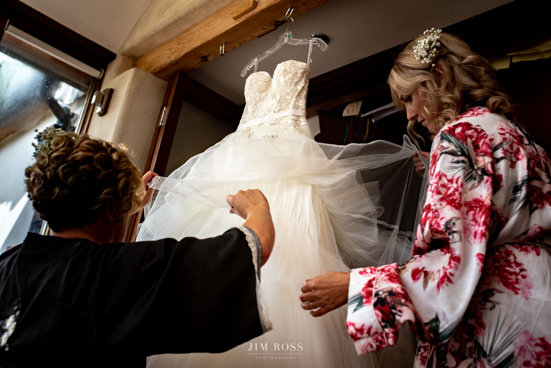 Inspecting the Welsh Yurt wedding dress