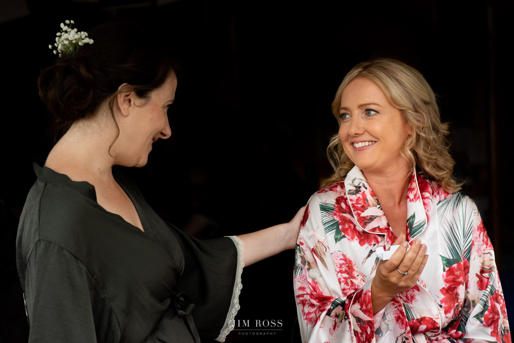 Affectionate moment from bridesmaid at Fron Farm