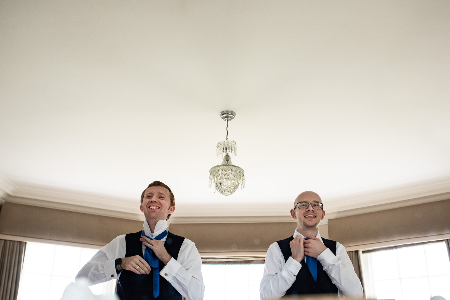 Groomsmen doing their ties