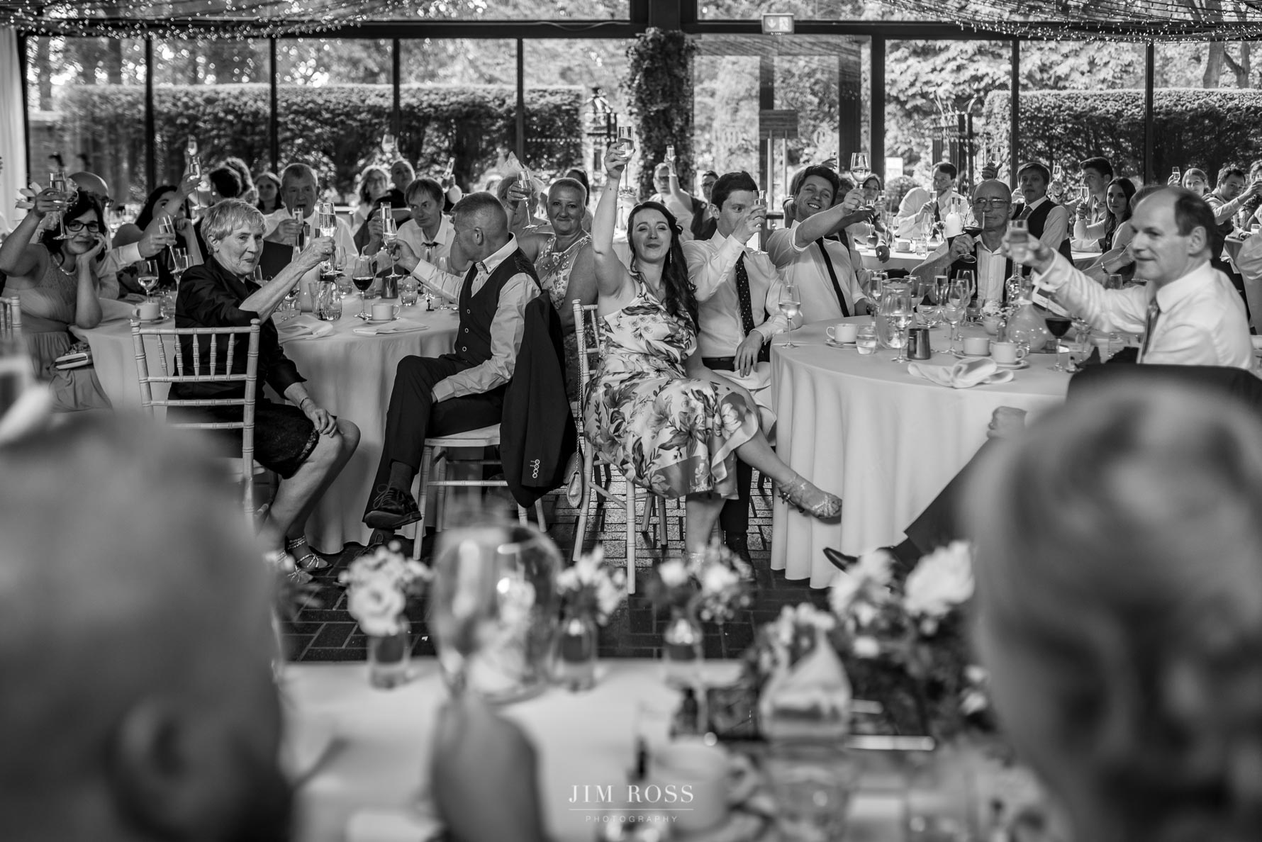 Raising a glass for bride and groom