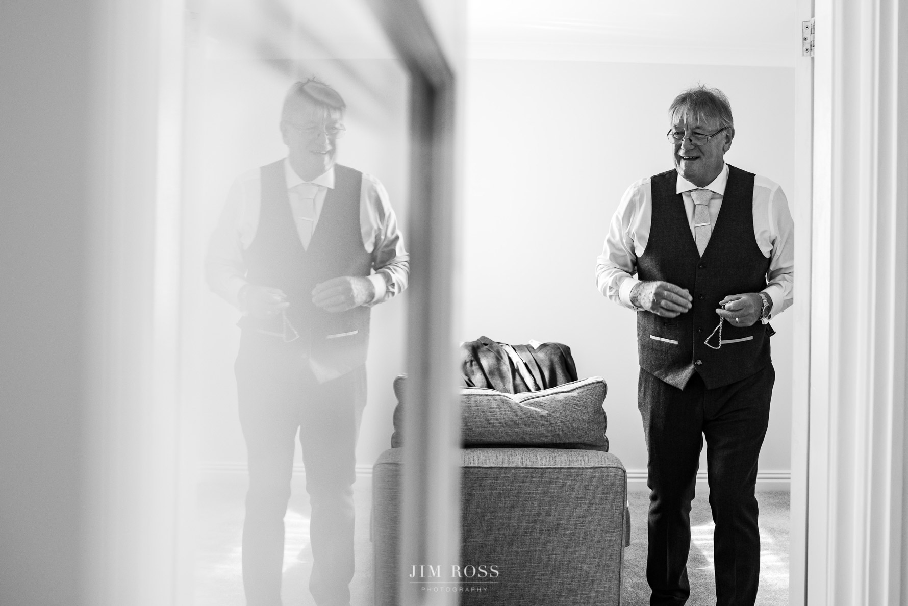 Father of the bride in reflection