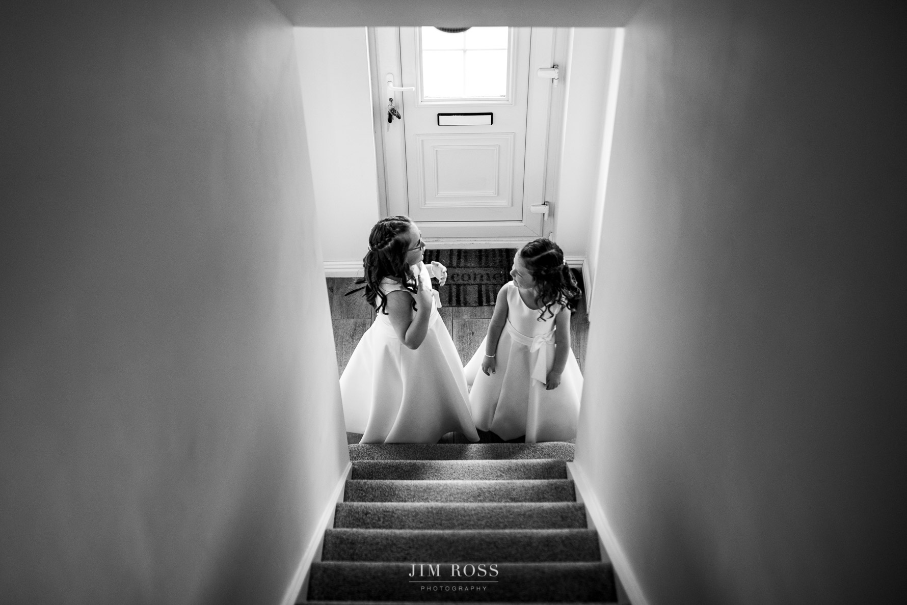 Flower girls at the bottom of the stairs