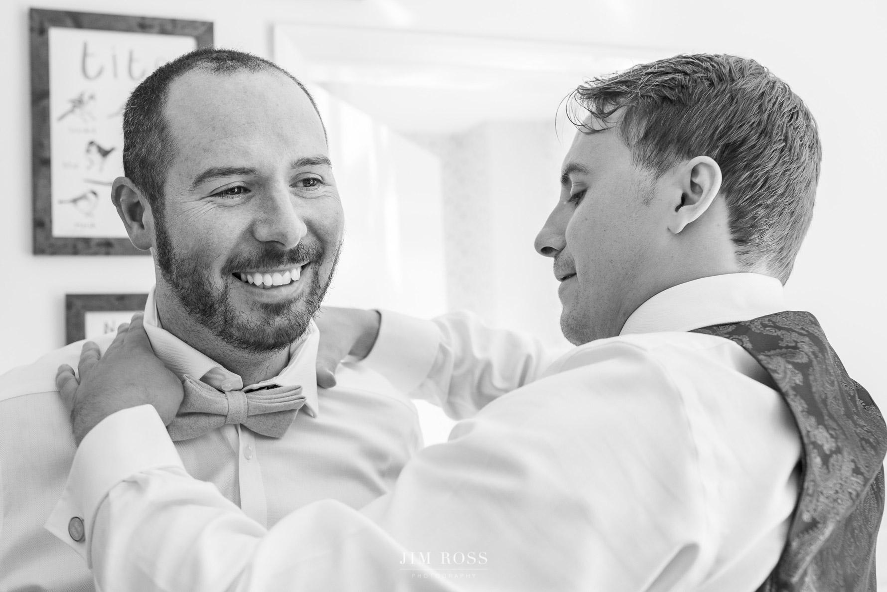 Fixing the groom's bow tie