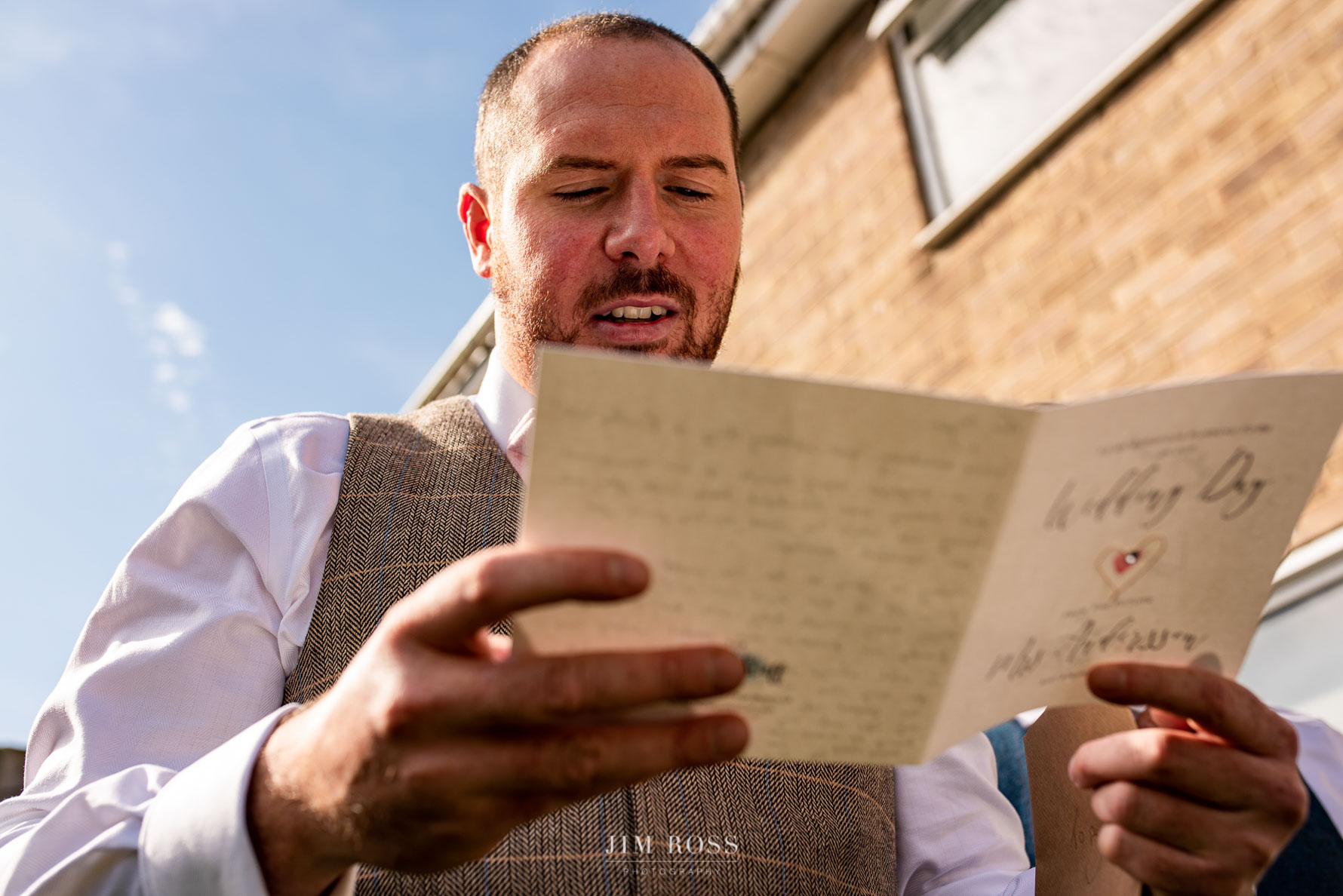 Groom reading card from bride-to-be
