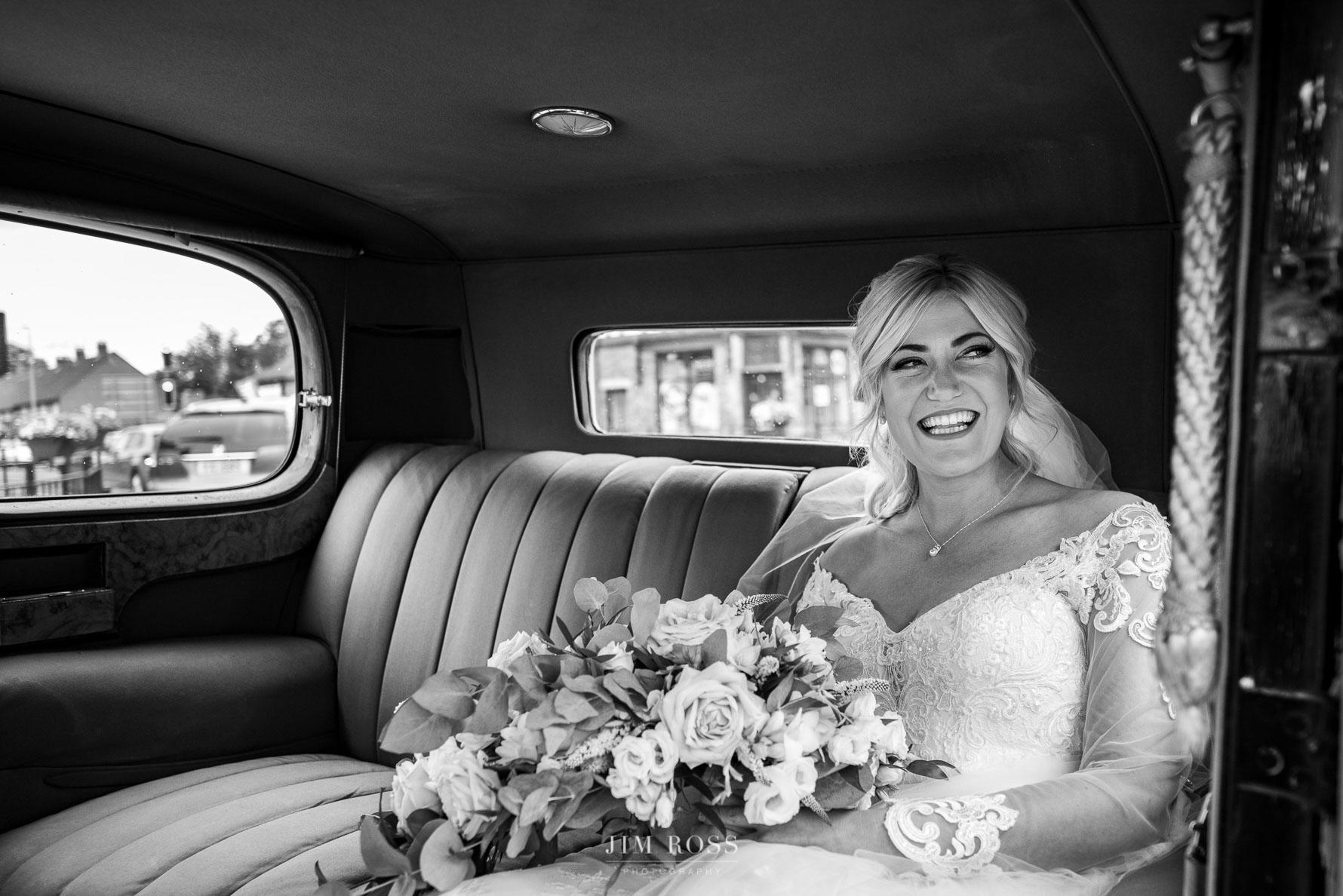 Bride in Rolls Royce car