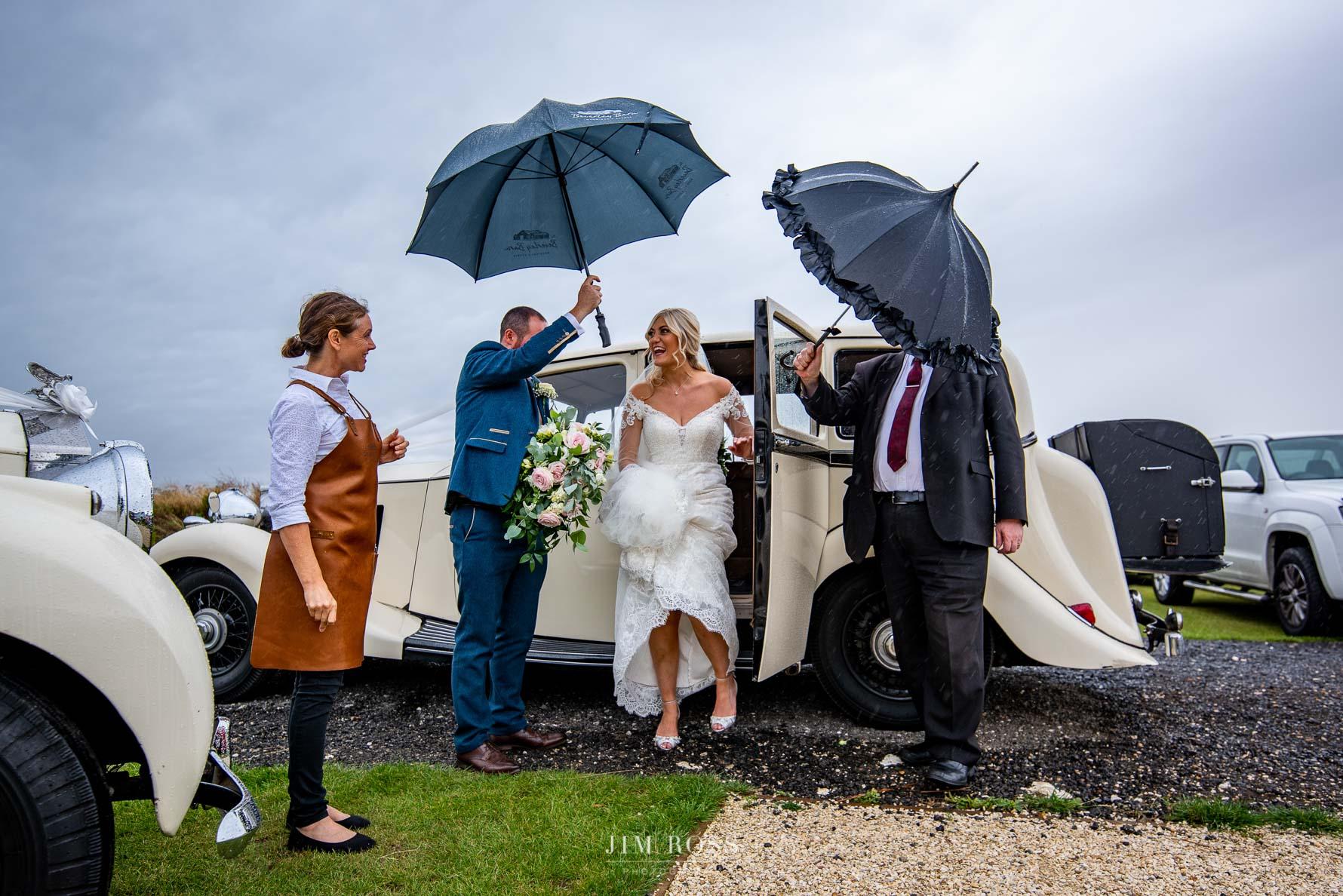 Stepping out Rolls Royce wedding car