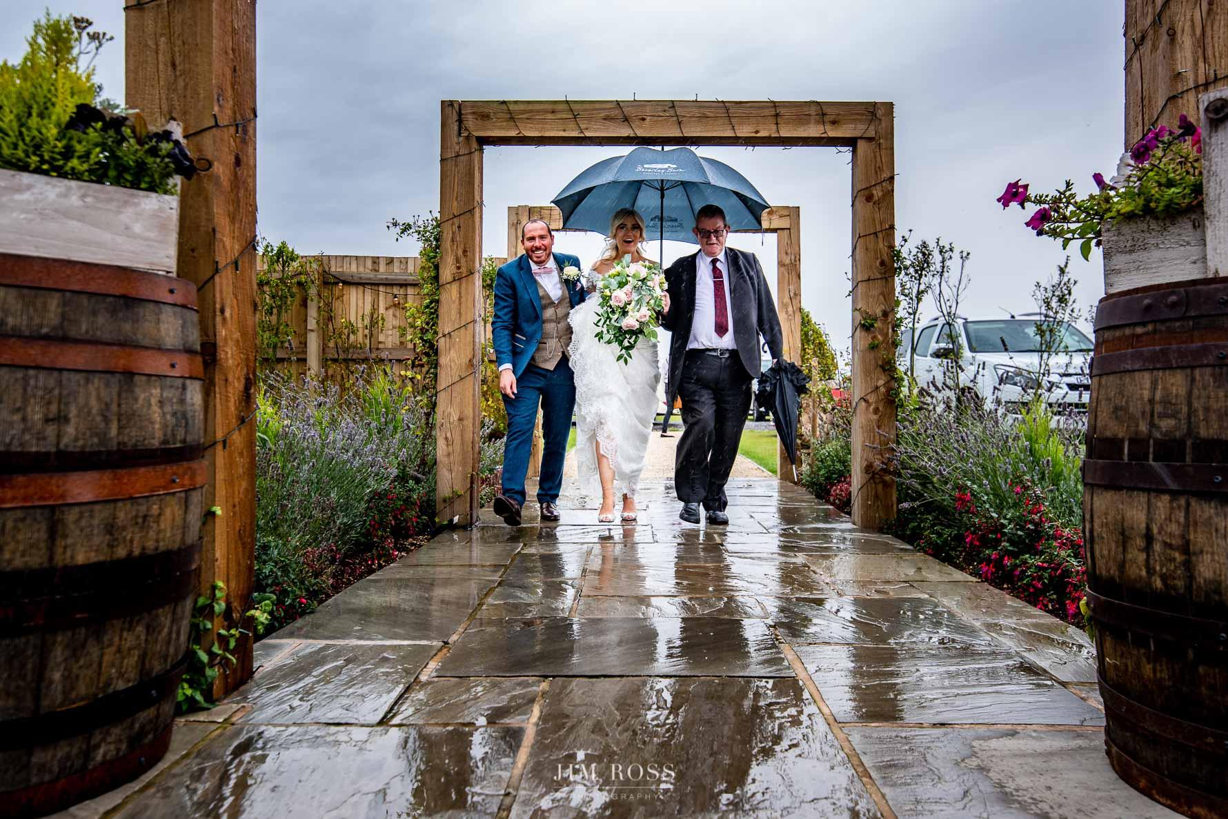 Couple arrive in the rain