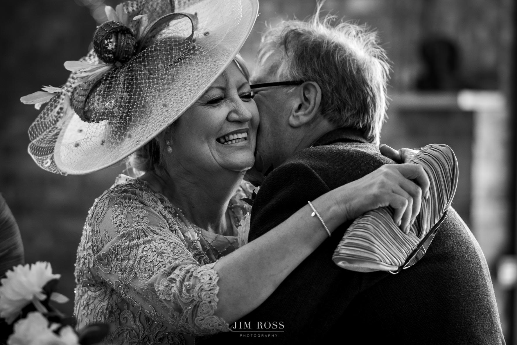Bride parents hug