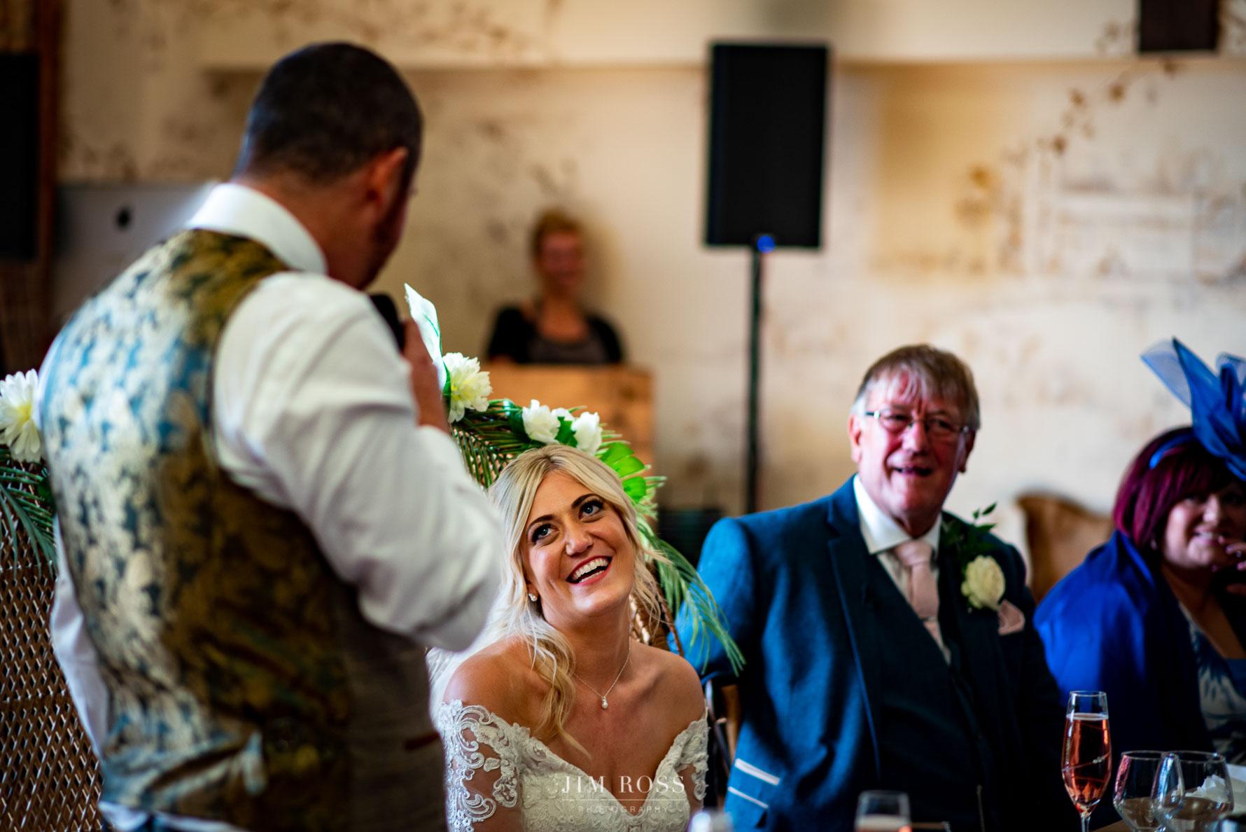 Bride admiring new husband speech