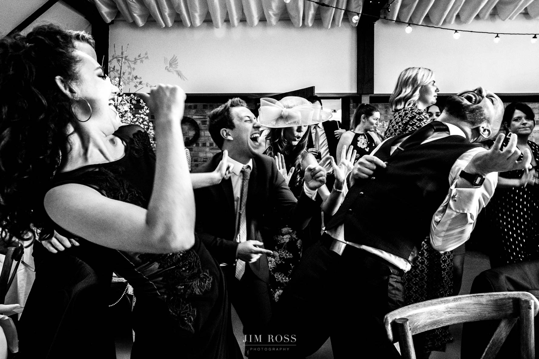 Wedding guests rocking air guitar