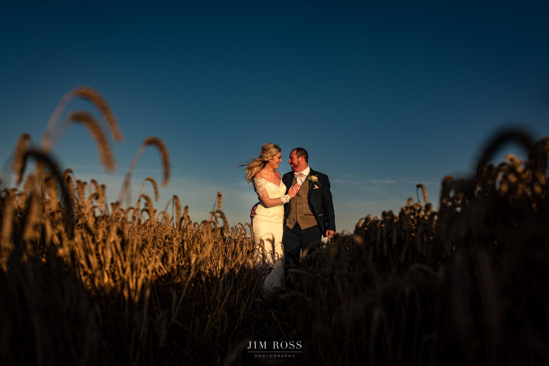 Wedding couple in corn field