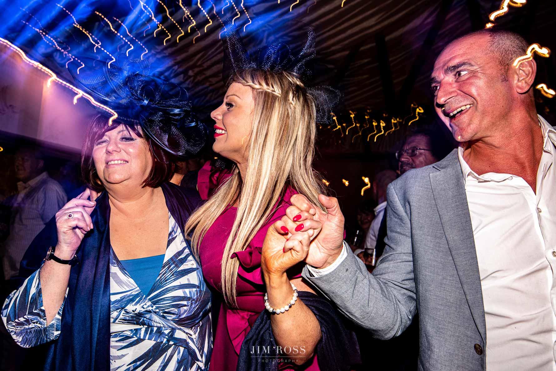Family wedding party dancing fun
