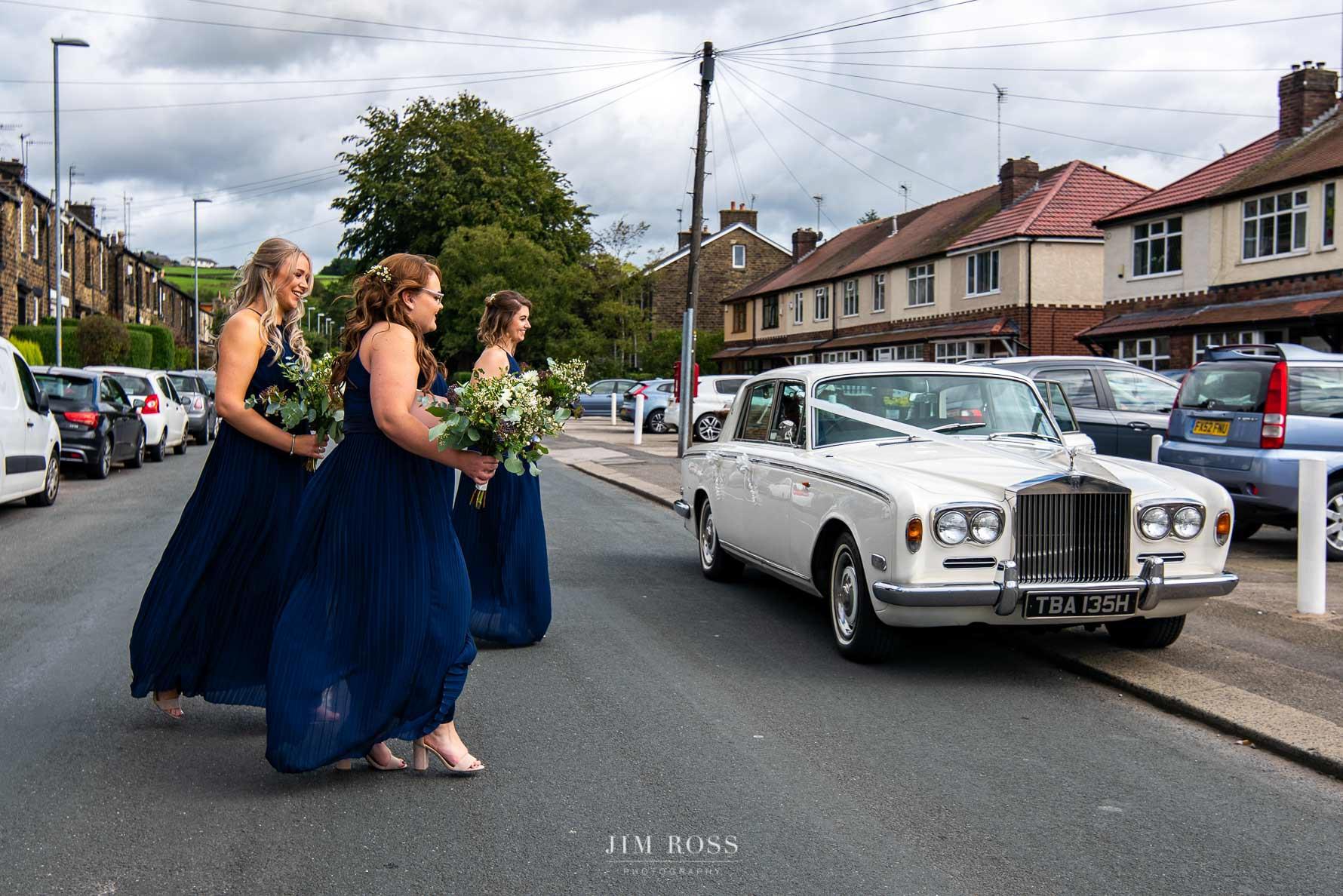 bridesmaids crossing road