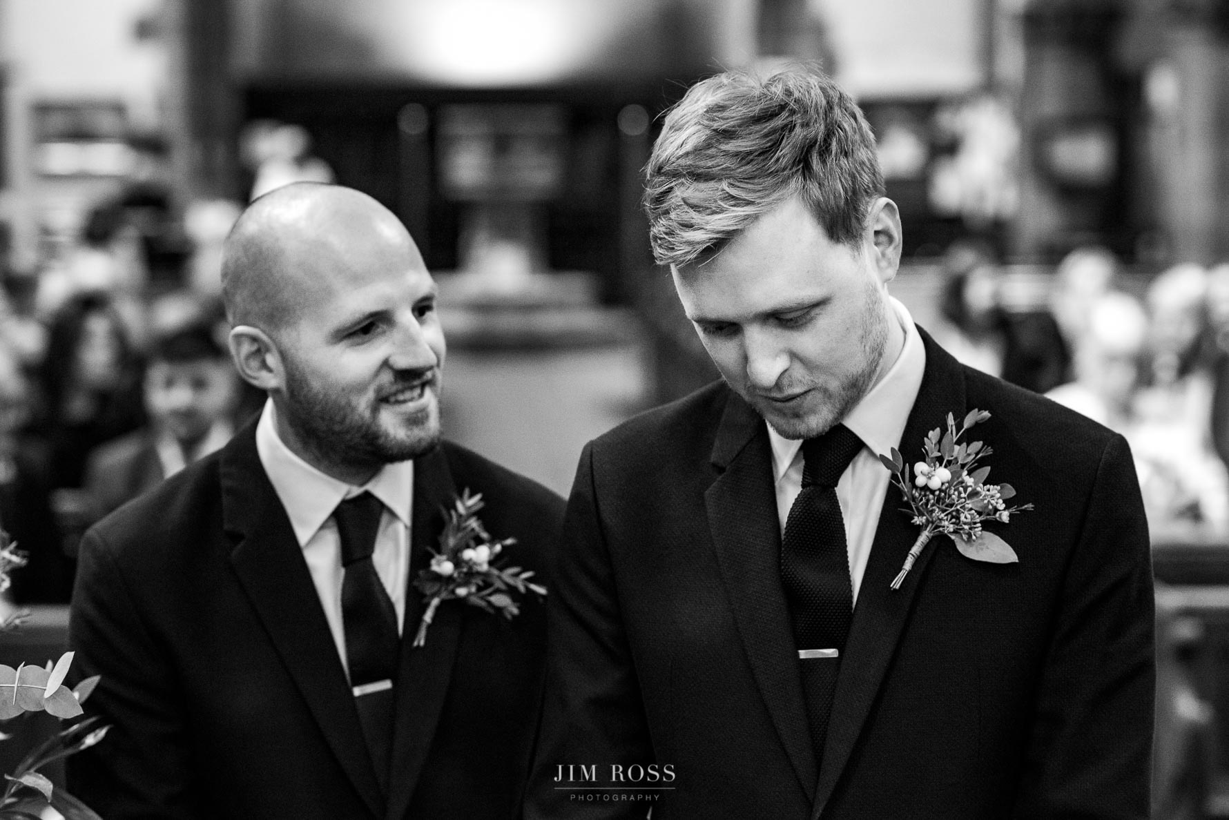Groom and best man in church