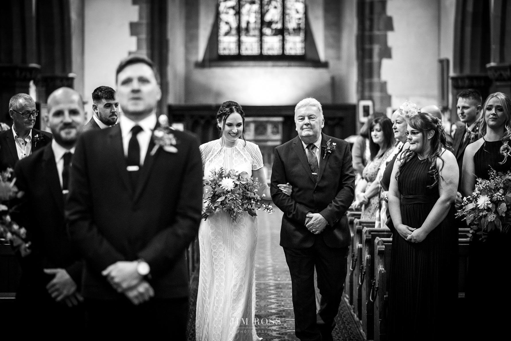 Nervous groom as bride arrives