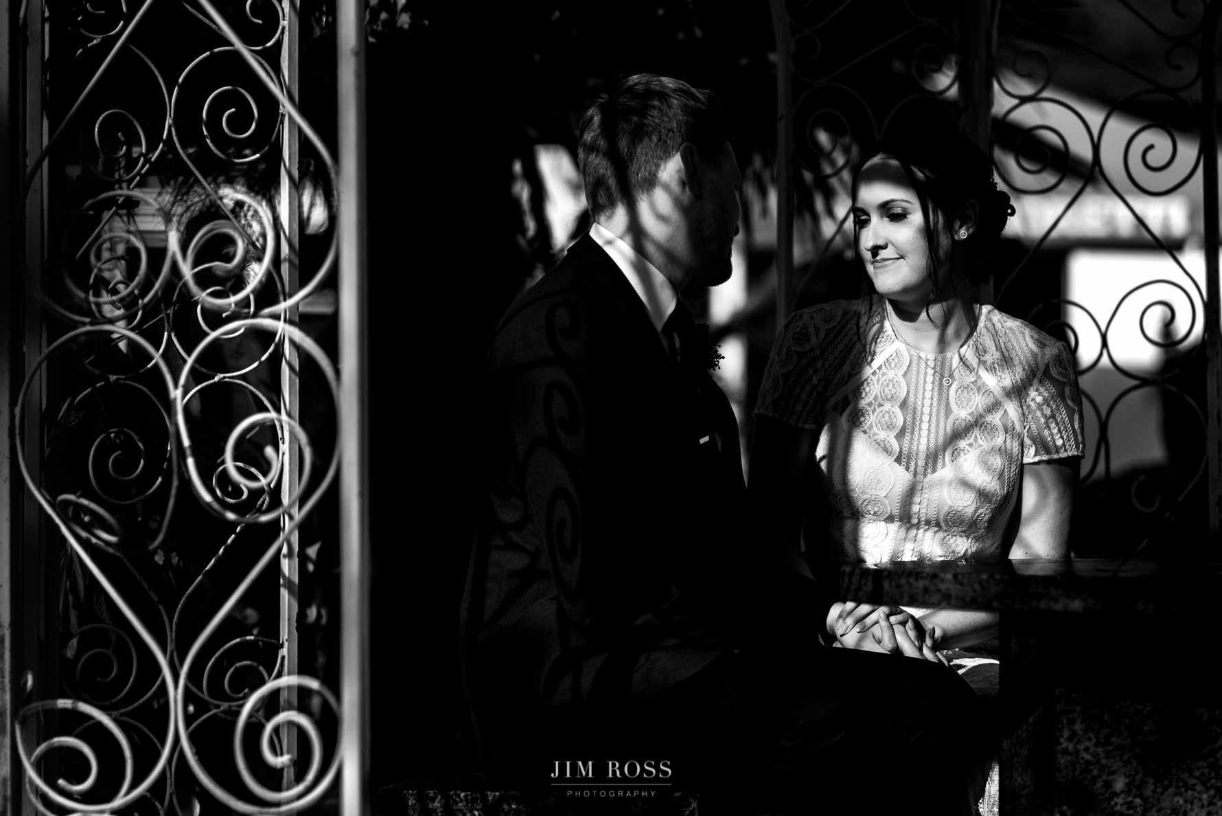Striking newlywed portrait holding hands