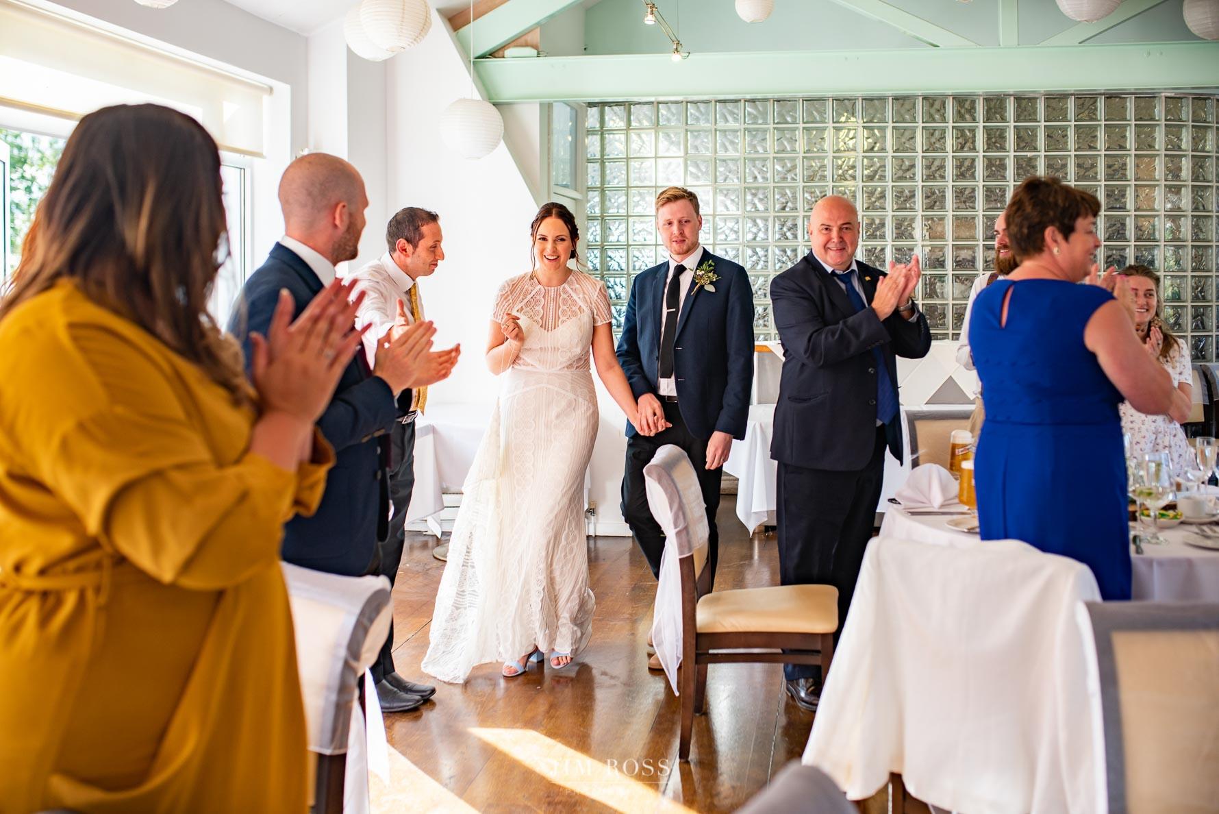 Bride and groom arrive for wedding breakfast
