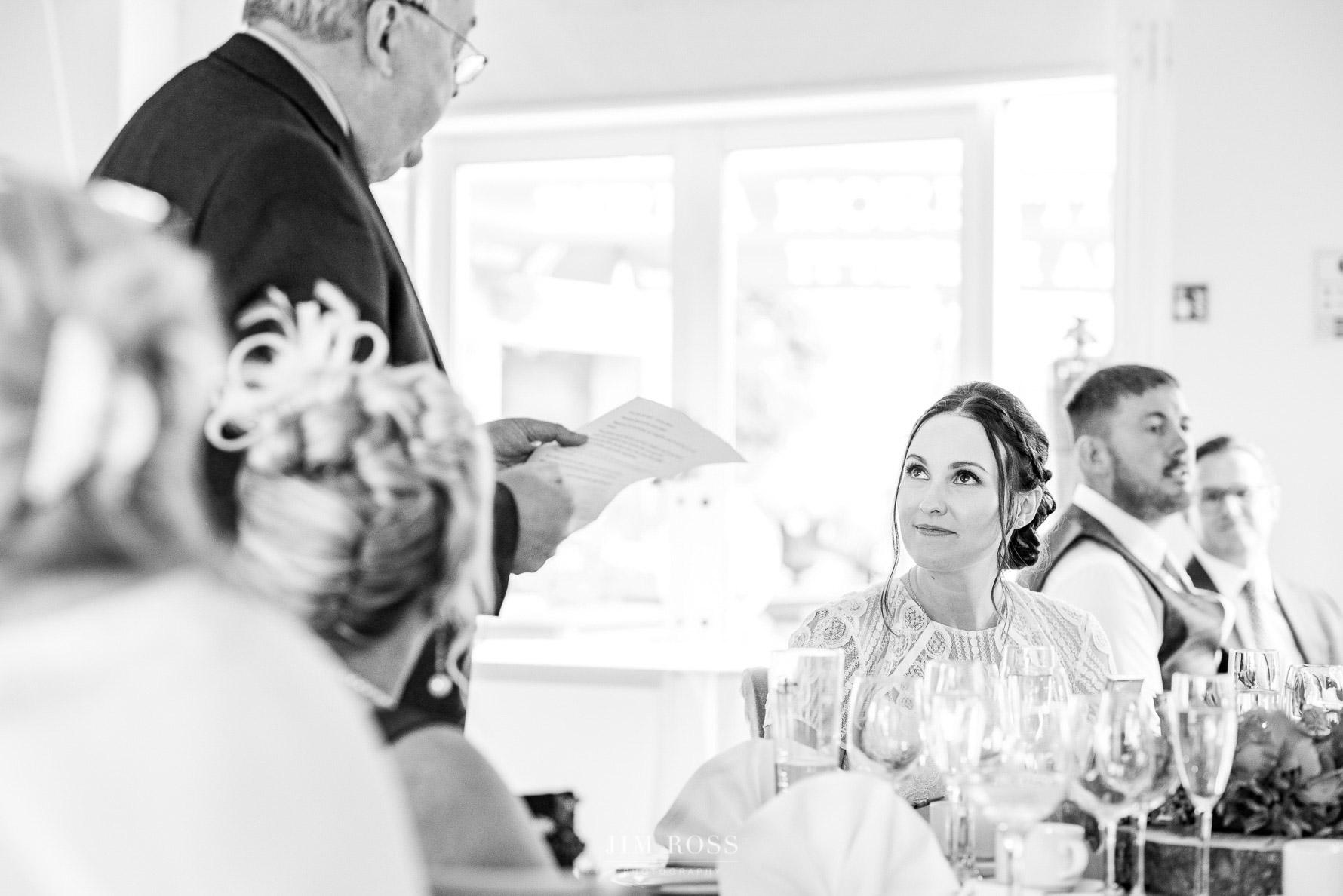 Bride looks lovingly at Dad in speech