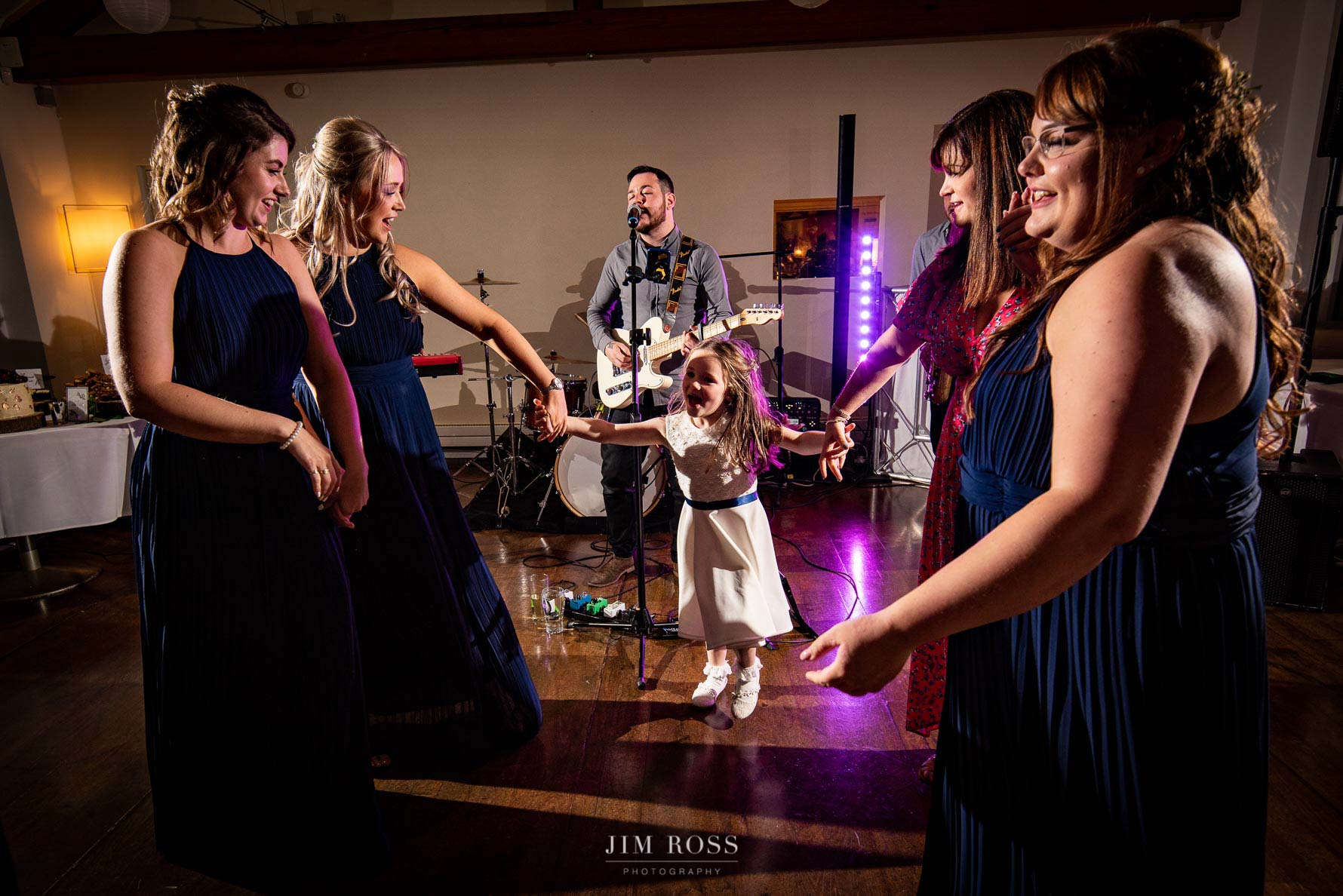 Bridesmaids dancing to Colour Blue band