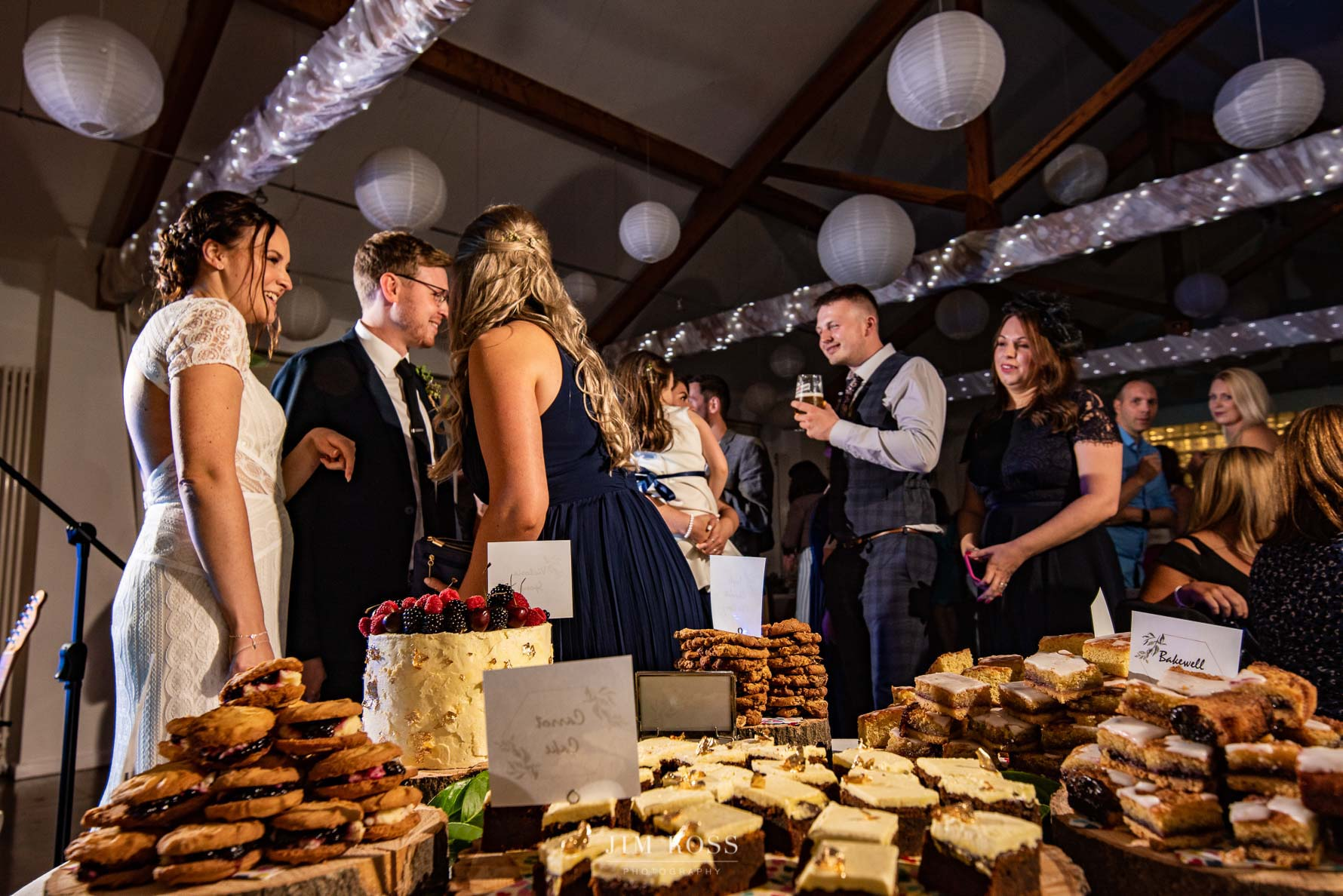 Cake table and wedding guests