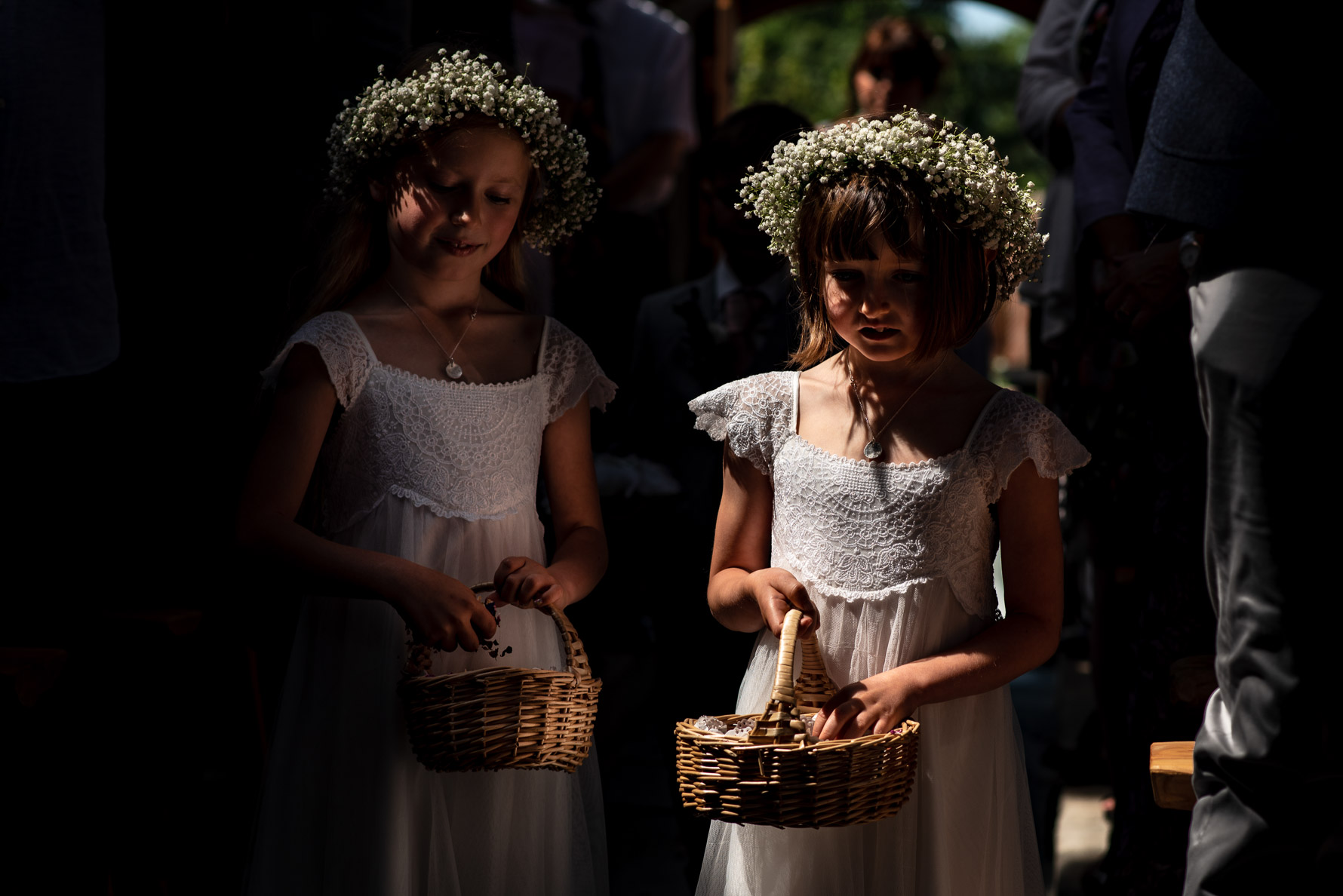Flower girls in dramatic light